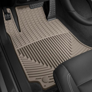 A beige floor liner is shown on the driver's side floor of a vehicle.
